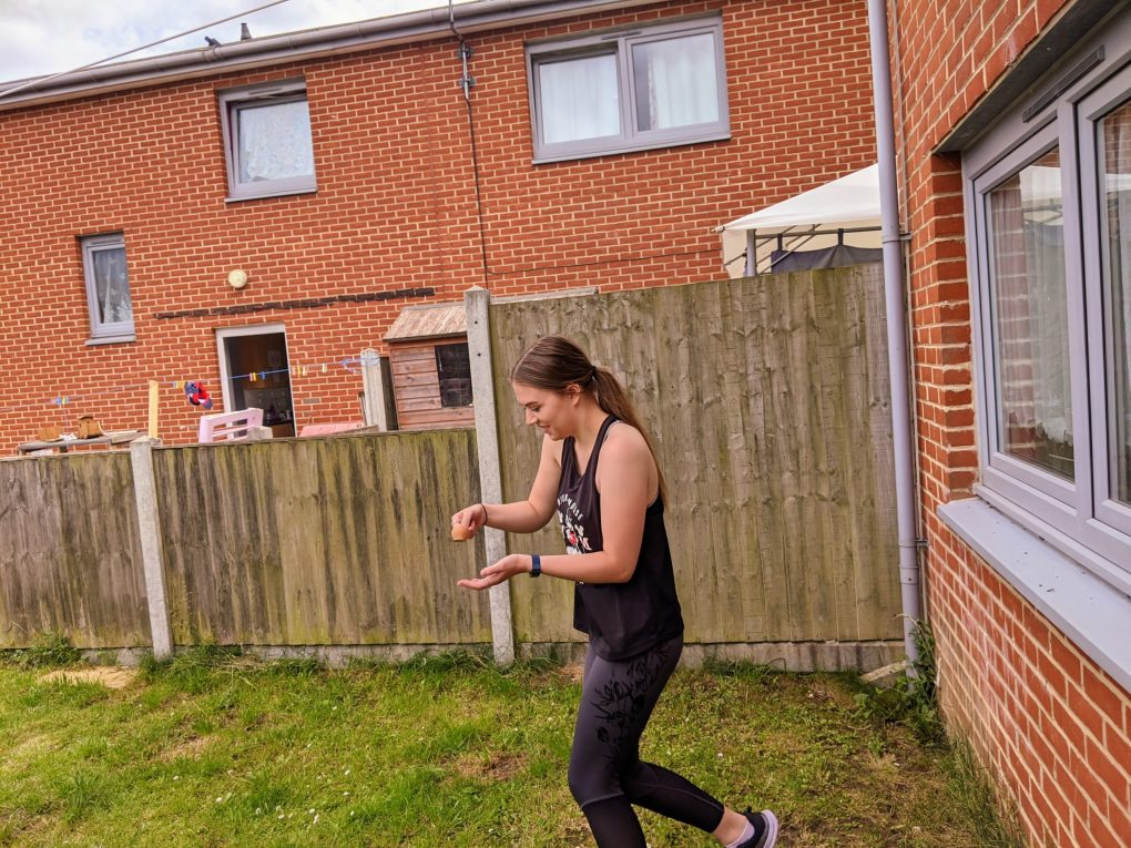 Lauren running in the egg and spoon race for the retro sports day
