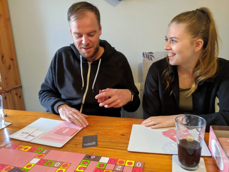 Lauren and James laughing playing game of ham
