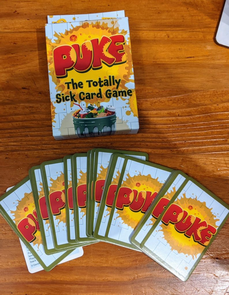 Puke playing cards and game box