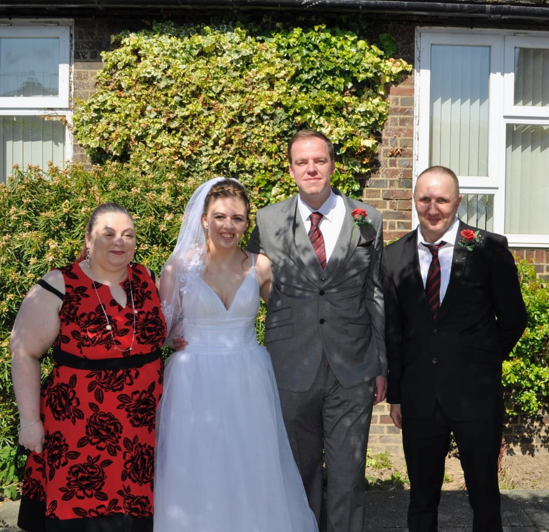 Mother of the bride, bride, groom and father of the bride at a COVID wedding