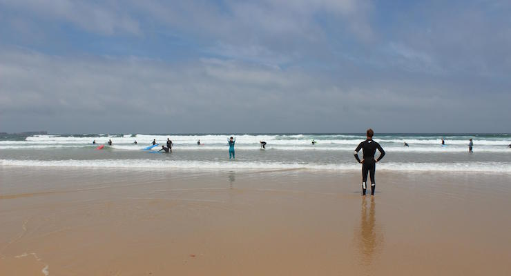 Surfers in Peniche, Portugal. Copyright Gretta Schifano
