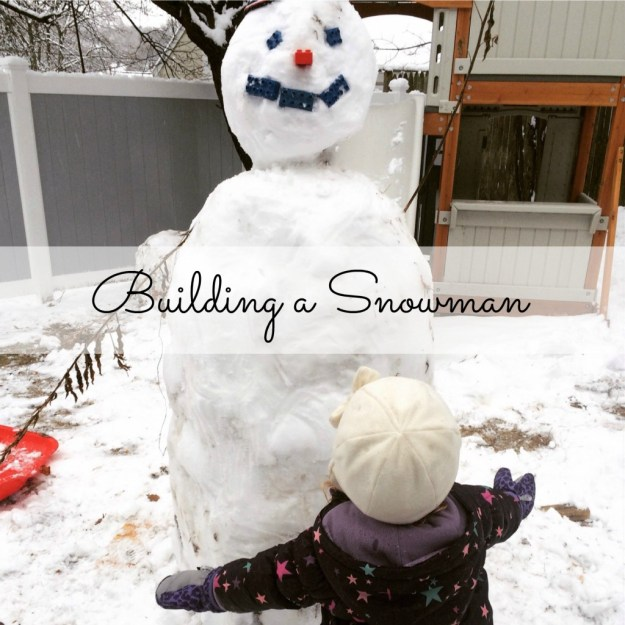 Country Kids Building a Snowman