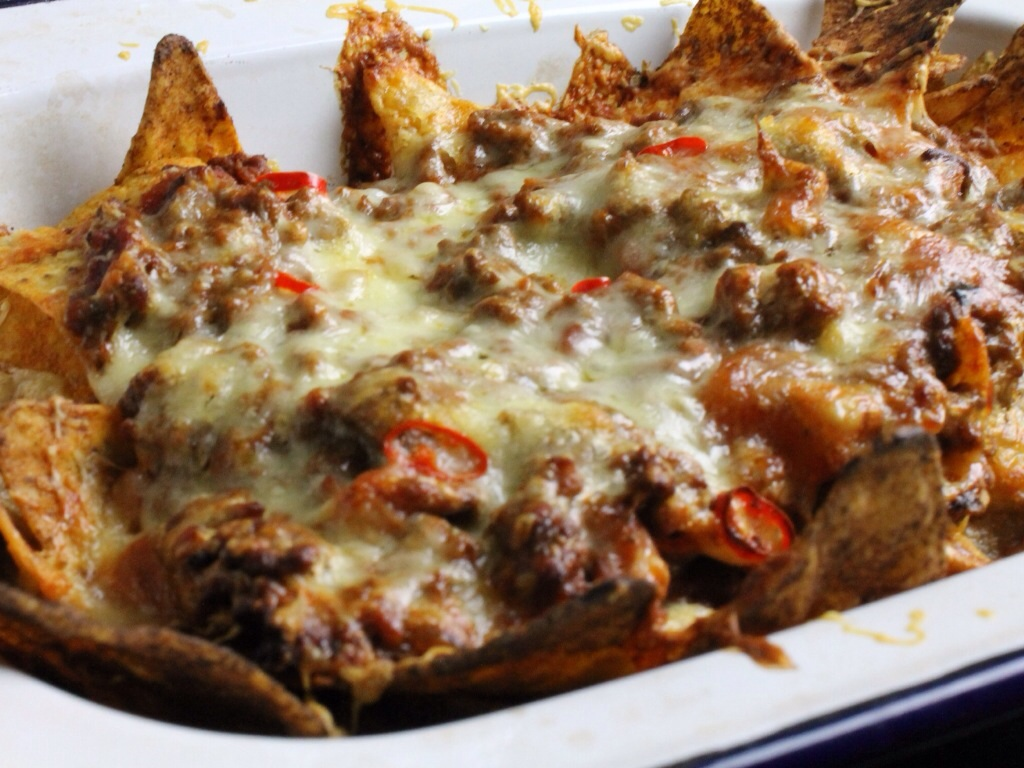Nachos topped with bolognese