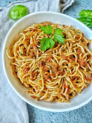 Bowl of spaghetti with sun-dried tomato pesto