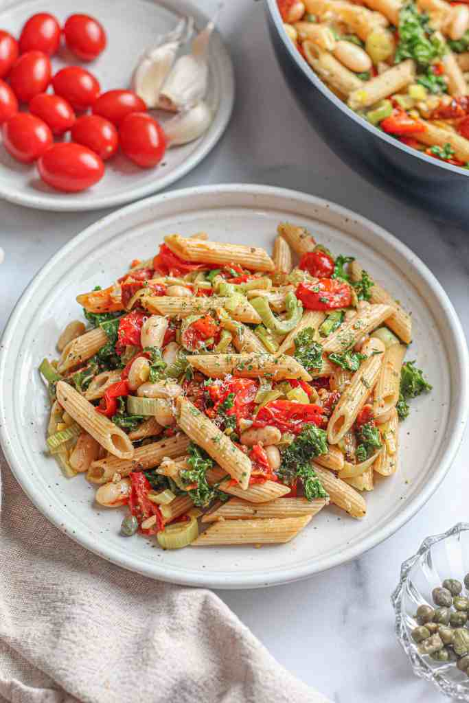 Penne with roasted tomatoes served on a plate