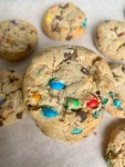This recipe may just be the best soft and chewy Monster Cookies you will ever try. These amazing M&M Cookies are a deliciously buttery and packed with chocolate and peanut flavors. They're big, soft, chewy and absolutely mouthwateringly good. | Munchyesta.com