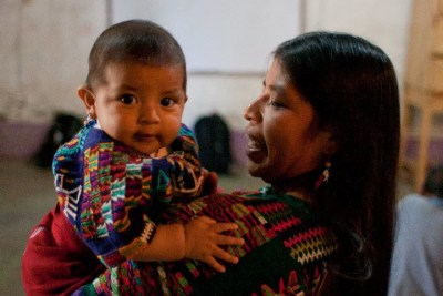 Guatemalan woman holding her baby