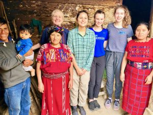 Joan and a couple of Catlin Gable volunteers stand with Guatemala team
