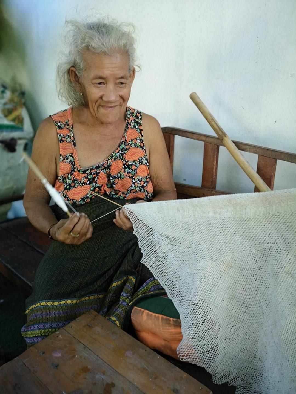 Nong hand sewing a fishing net