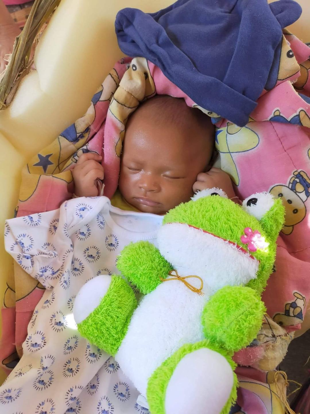 baby with donated plush toy