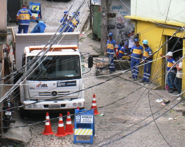 city cleaning ruble in laboriaux rocinha from demolitions
