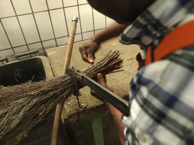 Assembling the old brooms from imported Italian twigs takes about 20 minutes -- munichFOTO