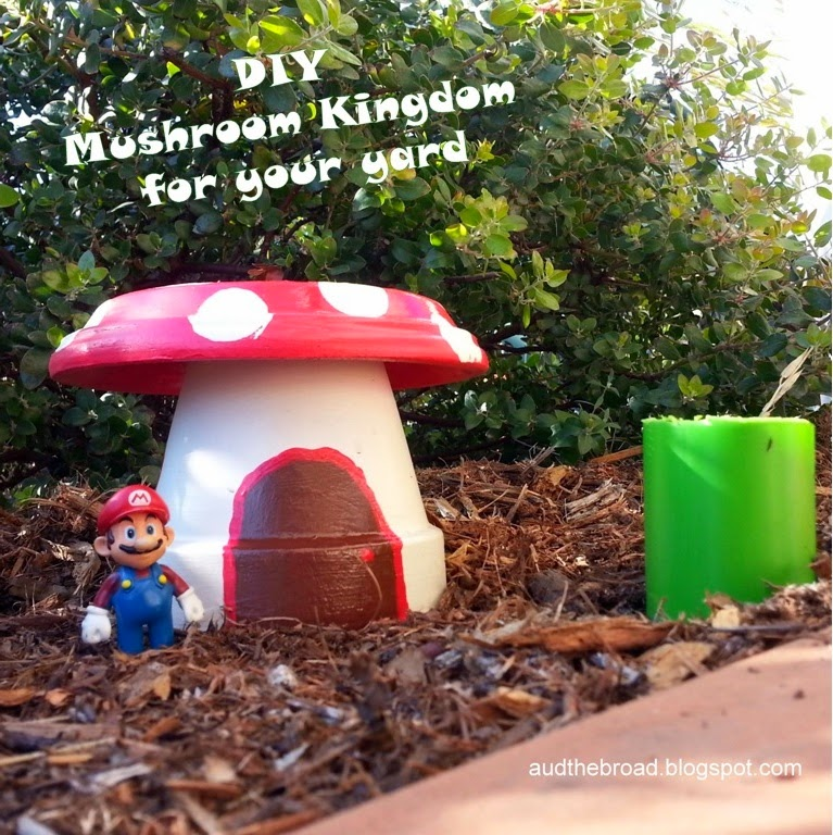 """Mario figure standing next to a mushroom house in a garden with text overlay """"DIY Mushroom Kingdom for your yard."""""""
