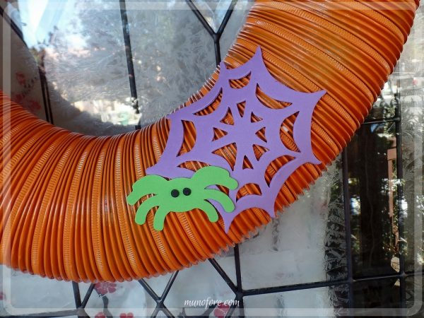 From trash to treasure - an old dryer vent becomes a festive Halloween wreath. Halloween craft, dryer vent pumpkin, easy Halloween decoration.