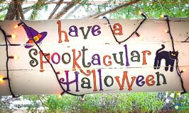 halloween sign hanging from porch