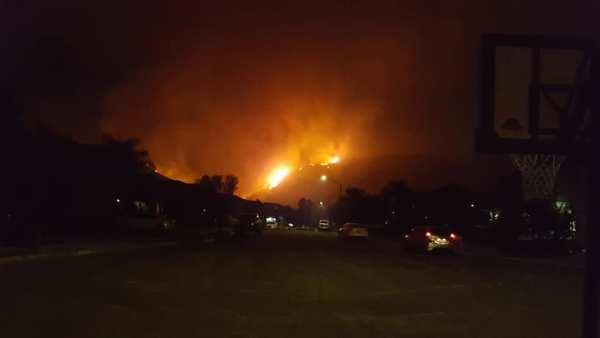 hill on flames from Tenaja Fire in Murrieta, CA