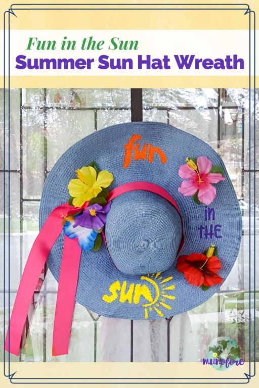 "Decorated summer beach hat hung on a door with text overlay ""Fun in the Sun Summer Sun Hat Wreath"""