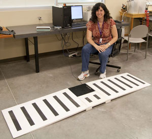 Dr. Munro with her walking force plate biomechanics device