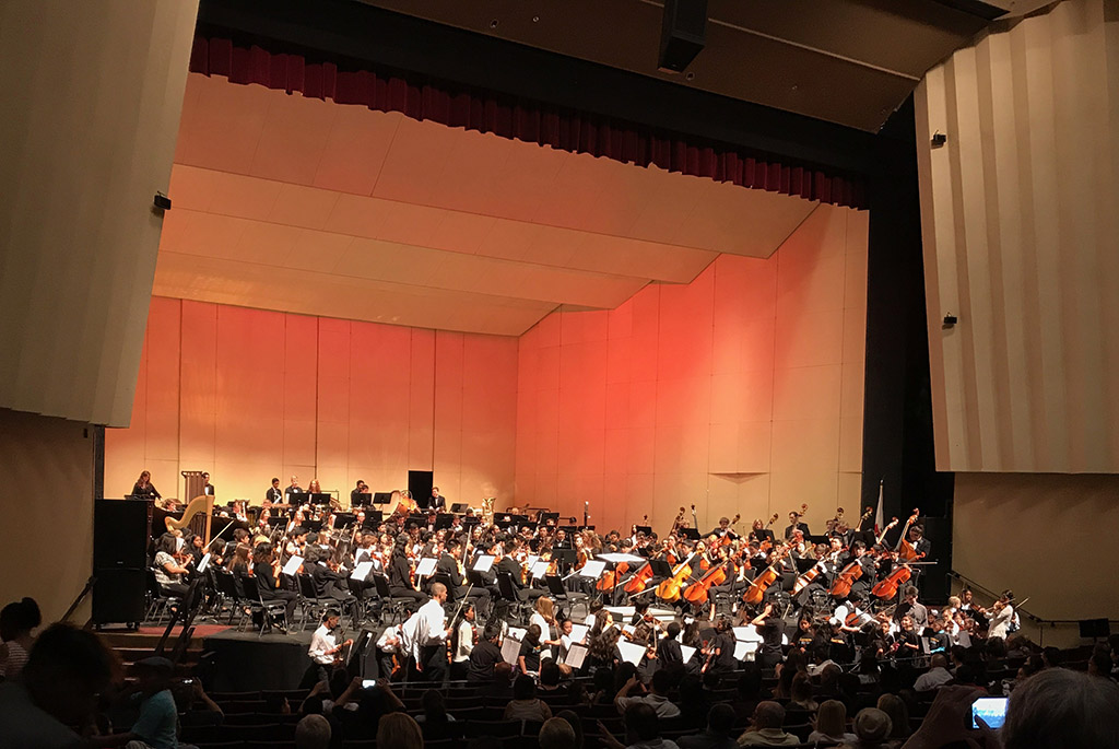 More than 300 young players crowd onto the Saroyan Theatre stage.