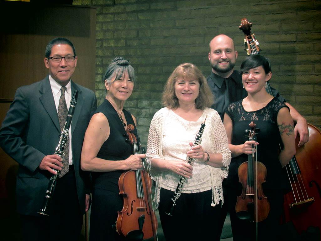Photograph of five musicians.