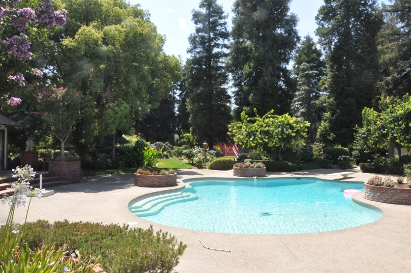 Time to relax: Tevye's dream home comes with a pool, of course, plus a pool house. Photo / The Munro Review