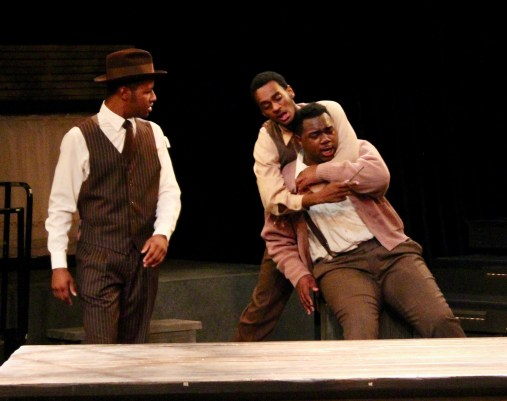 "Temper: Jalen Stewart, left, as Black Rat, Josh Slack, as Bigger, and Jimmy Haynie as Buddy in ""Native Son."" Photo / Fresno State"