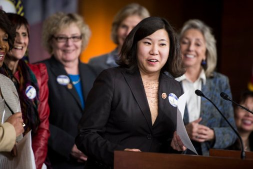 "UNITED STATES - APRIL 8: Rep. Grace Meng, D-NY, participates in the House Democratic women news conference to mark ""Equal Pay Day"" on Tuesday, April 8, 2014. The lei was made out of Pay Day candy bars strung together. (Photo By Bill Clark/CQ Roll Call)"