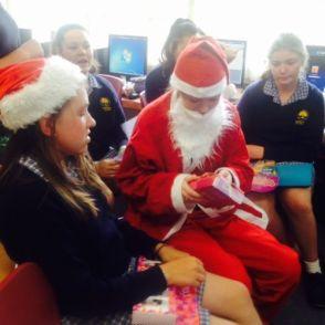 Santa opens her gift