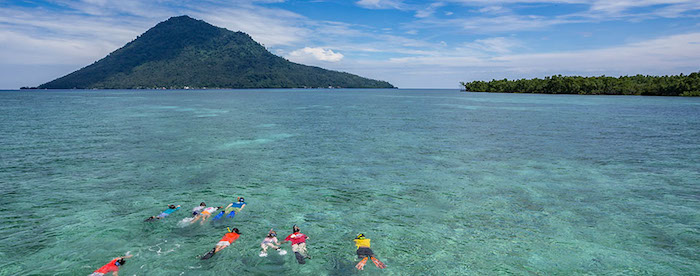 Family snorkeling in Bunaken