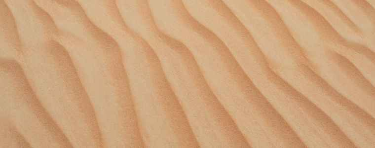 wavy patterns on the desert sand