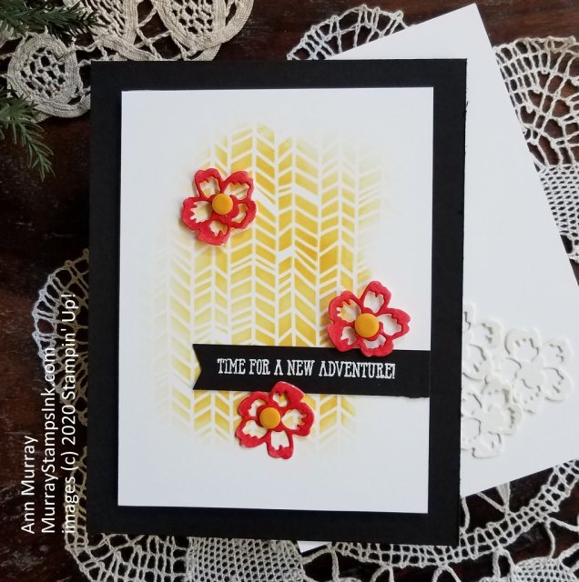yellow stenciled background with 3 flowers