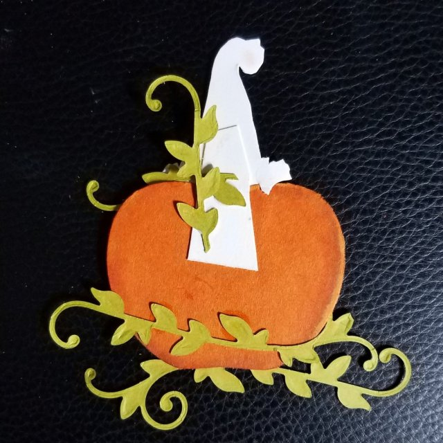 attaching foliage to back of pumpkin