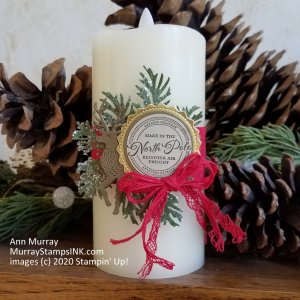 candle wrap featuring ice tipped pine boughs and a reindeer