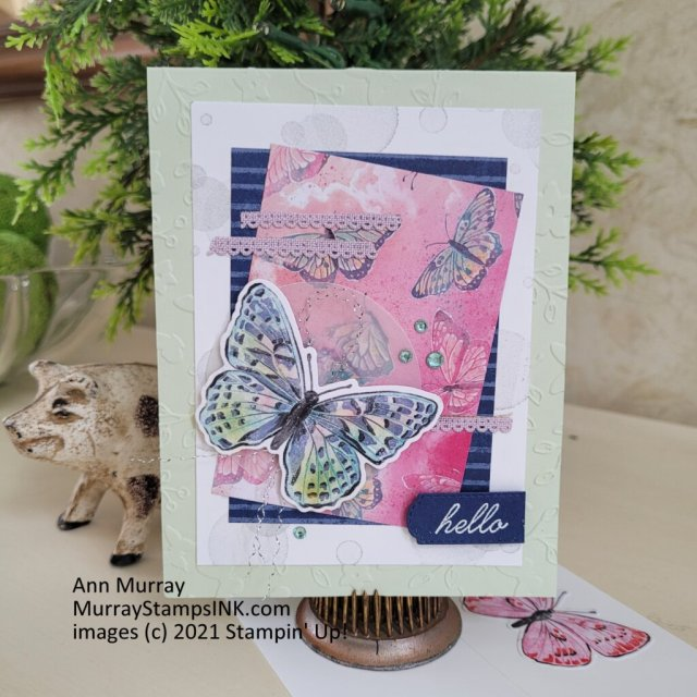 die-cut butterflies and scraps of ribbon with lots of texture