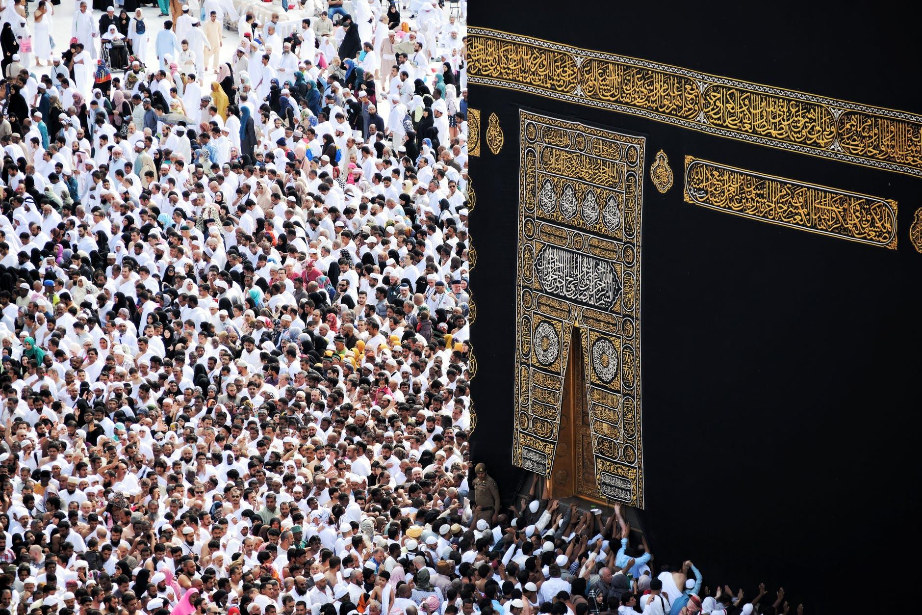 photo of people gathering near kaaba mecca saudi arabia
