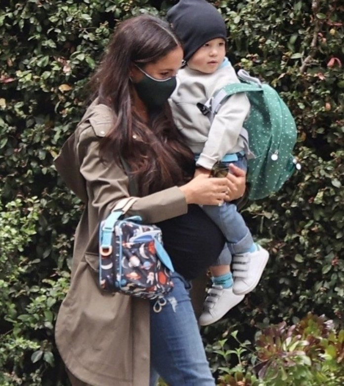 Heavily pregnant Meghan Markle pictured taking son Archie to school (photos)