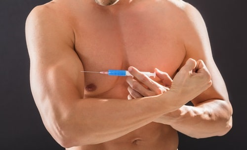 man injecting steroids