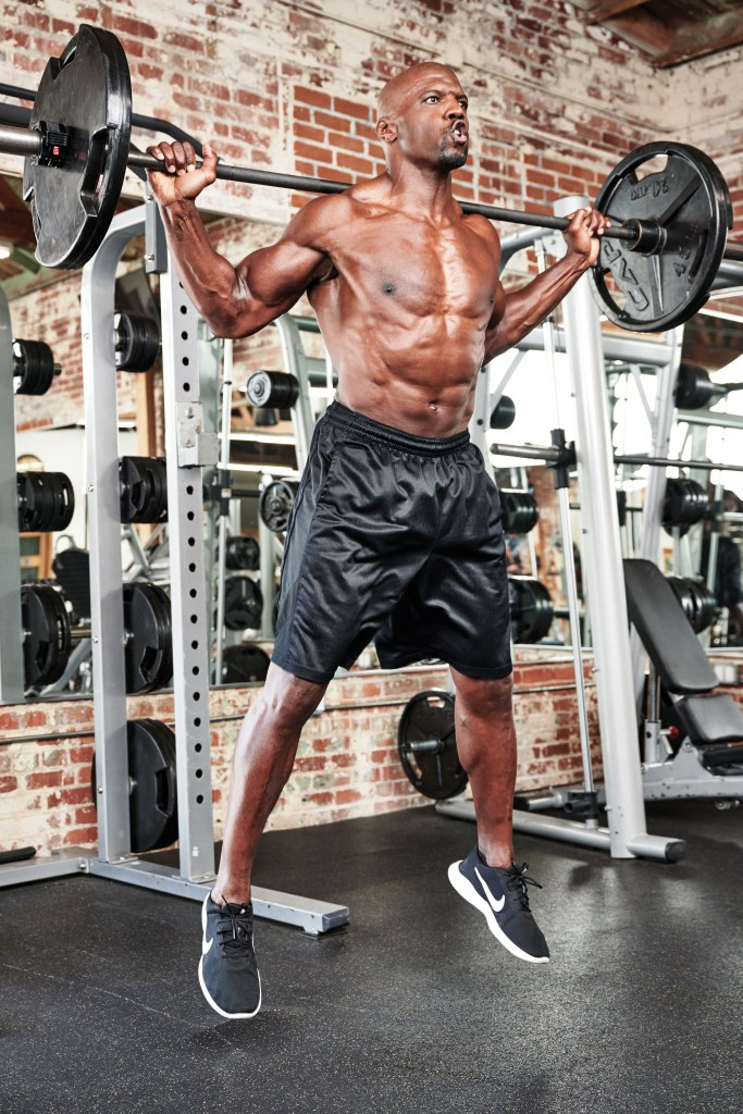 Terry Crews working out with a Barbell