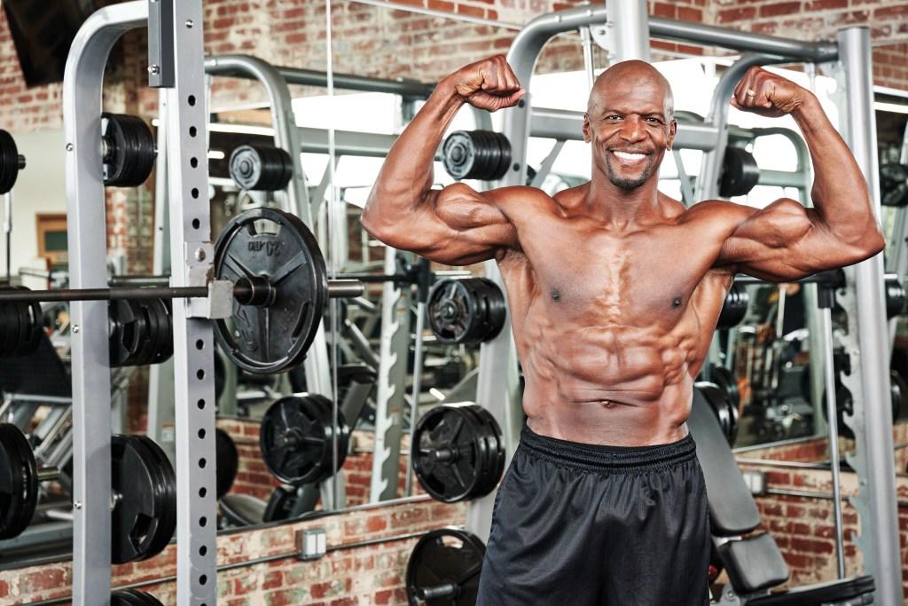 Terry Crews flexing his biceps
