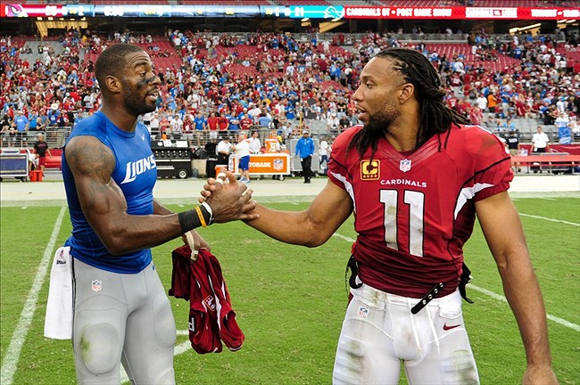 Both Calvin Johnson (left) and Larry Fitzgerald (right) have overweight BMIs.