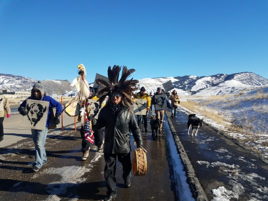 Phil Littlethunder walked out front of his cousin Rosalie's sacred memorial parade through the Roosevelt Arch and down the old road out of the Yellowstone towards the park boundary.