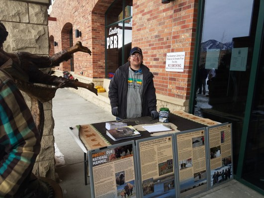 Toe stood at the information booth near the front door of the library, answering questions and conversing with folks about the Yellowstone buffalo.