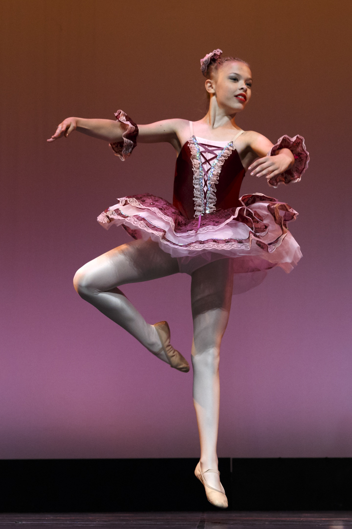 young ballerina in a pose on stage