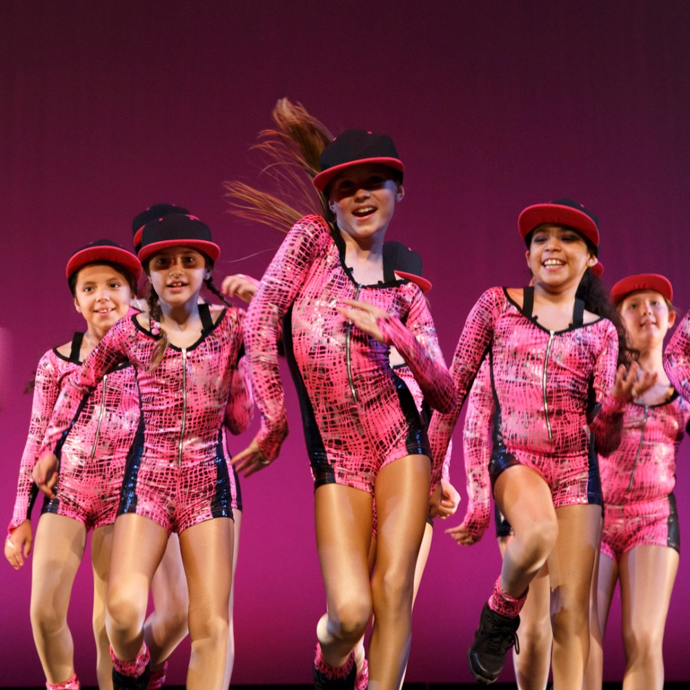 young female hip hop dancers in pink costumes