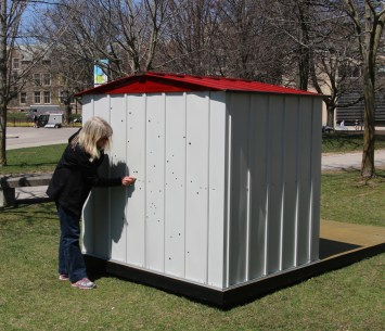Dianne Bos installing Star Shed at McMaster Museum of Art