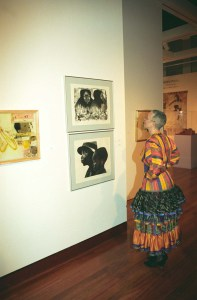 "Camille Olivia Hanks Cosby viewing ""Lovey Twice,"" 1976, and ""Two Generations,"" 1979 by Elizabeth Catlett in ""Rediscovery: Works from the Spelman College Collection,"" 1996."