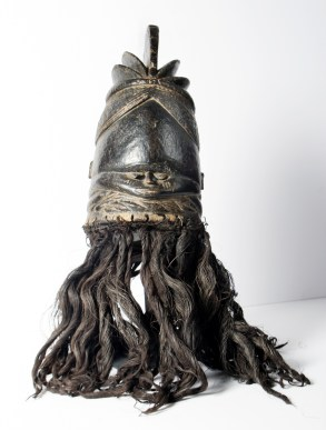 Sowei Mask, early – mid 20th century, Mende, Sierra Leone, Wood, pigment, plant fibers, raffia, 21½ x 8½ x 9½ inches, Gift of Mabel Murphy Smythe-Haith, 1980.1.47