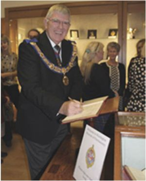 tony-harrison-prgm-signing-the-visitors-book