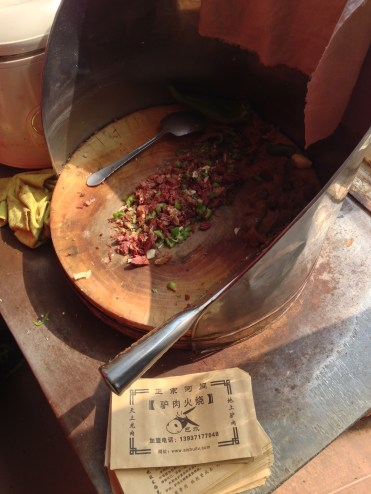 Chopped Donkey meat mixed with peppers and raw garlic