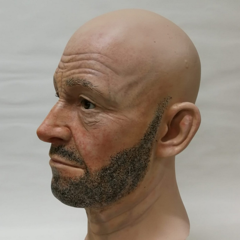 Polyester display head with painted wrinkles and fine sand stubble